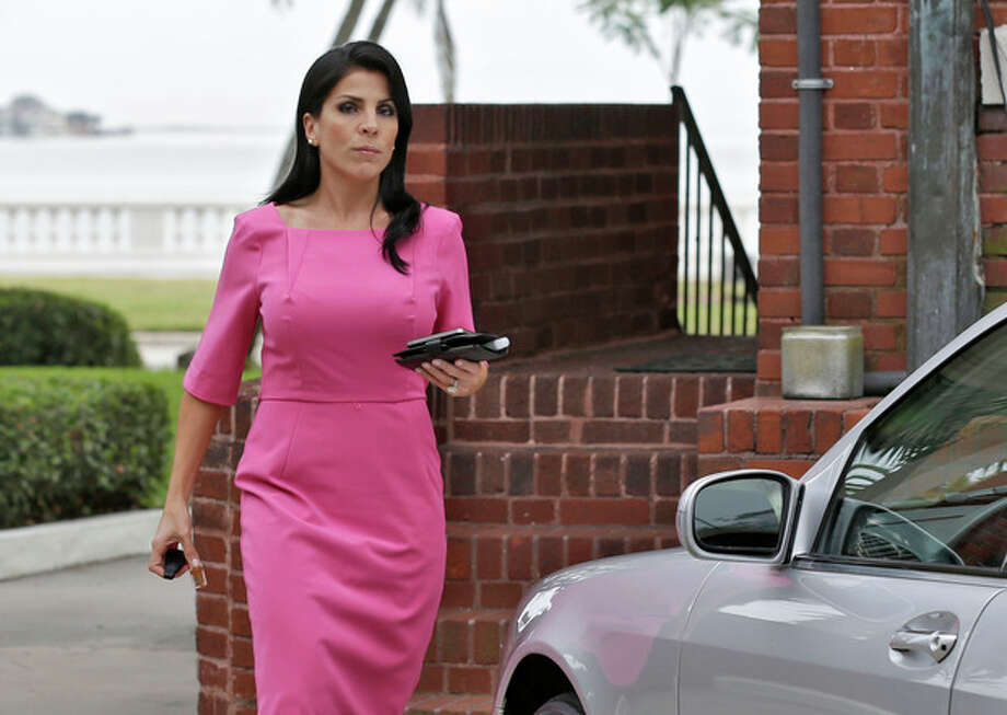 Jill Kelley leaves her home Tuesday, Nov 13, 2012 in Tampa, Fla. Kelley is identified as the woman who allegedly received harassing emails from Gen. David Petraeus' paramour, Paula Broadwell. She serves as an unpaid social liaison to MacDill Air Force Base in Tampa, where the military's Central Command and Special Operations Command are located. (AP Photo/Chris O'Meara) / AP