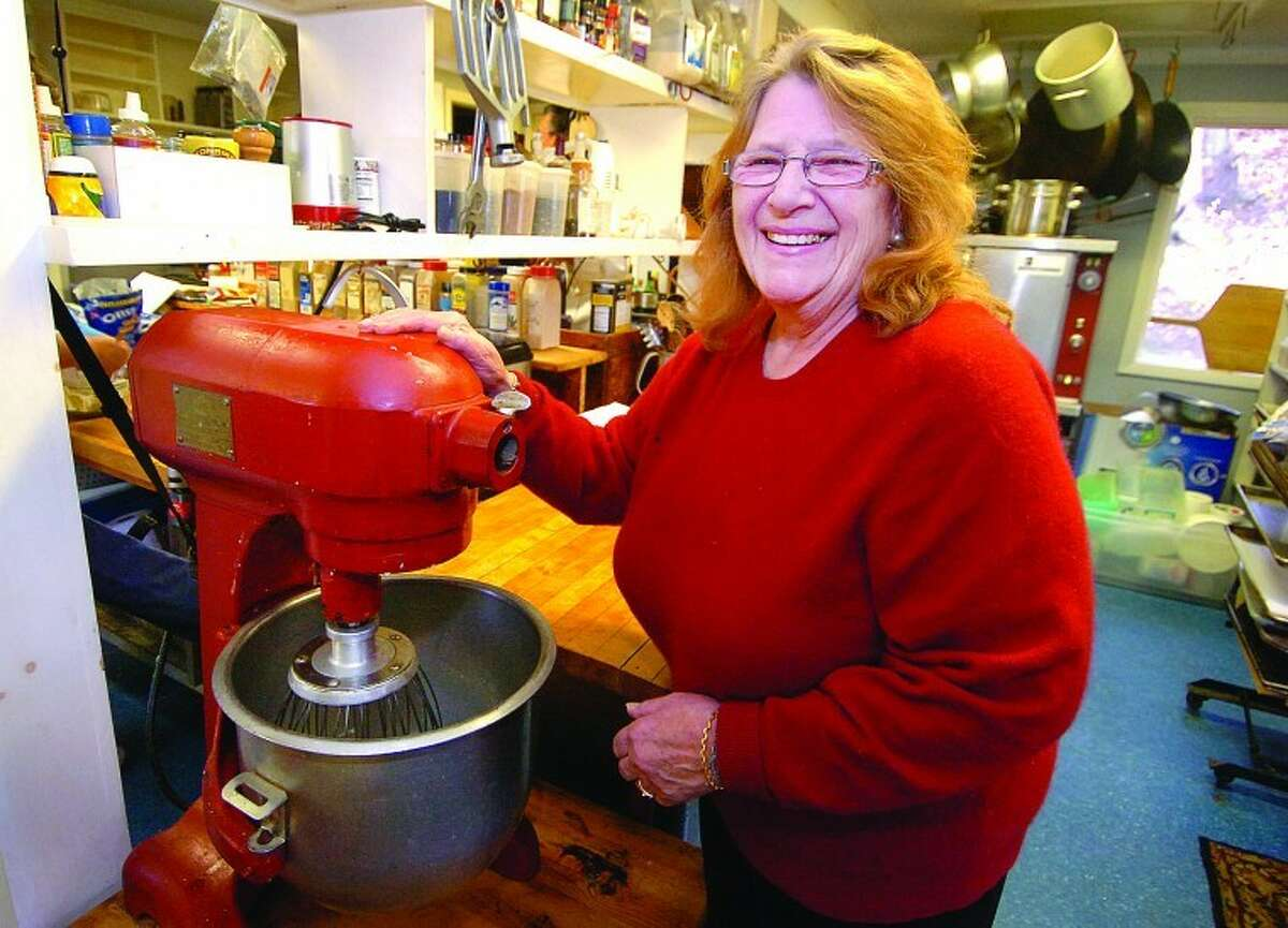 Marianne Wilson uses a vintage mixer to beat egg whites in her catering kitchen.
