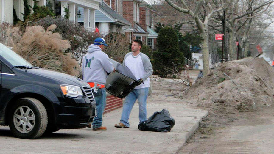 Scenes from King Industries' trip to Rockaway, N.Y., last weekend to help with Hurricane Sandy relief.Contributed photo