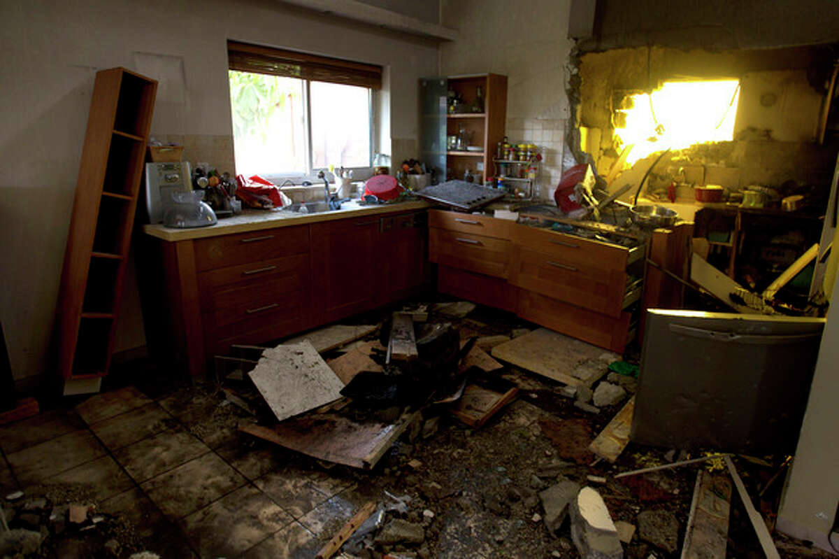 Debris in a kitchen of a house after a rocket fired by Palestinians militants from Gaza hit in a community near the Israel Gaza Border, southern Israel, Friday, Nov. 16, 2012. (AP Photo/Ariel Schalit)