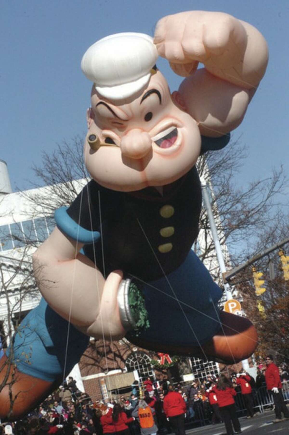 Hour photo / Matthew Vinci Popeye turns out on Atlantic Street in Stamford Sunday at the UBS Parade Spectacular.