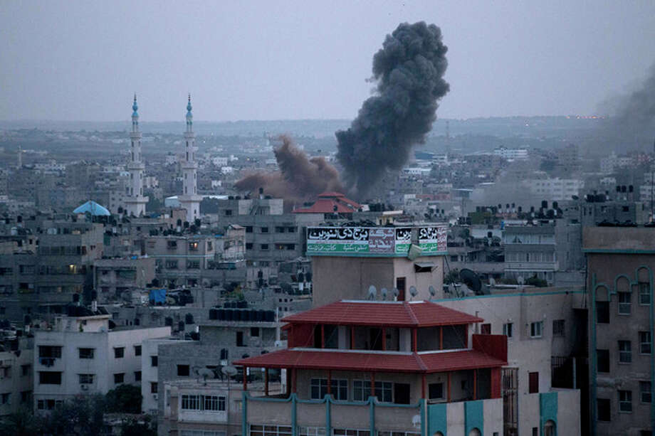 Smoke rises following an Israeli attack in Gaza City, Friday, Nov. 16, 2012. (AP Photo/Majed Hamdan) / AP