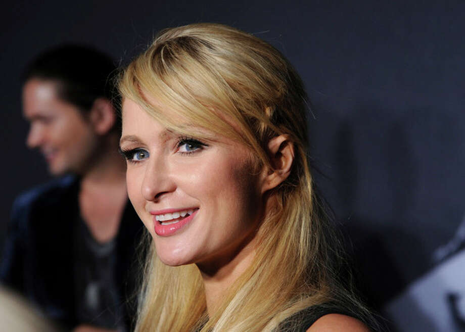 """FILE - In this Sept. 13, 2012 file photo, television personality Paris Hilton arrives at a """"Lady Gaga Fame"""" fragrance launch event at the Guggenheim Museum in New York. Roy Lopez Jr. pleaded no contest to receiving jewelry stolen from Hilton's home and was sentenced to three years of supervised probation on Thursday Nov. 8, 2012. (Photo by Evan Agostini/Invision/AP, File) / Invision"""