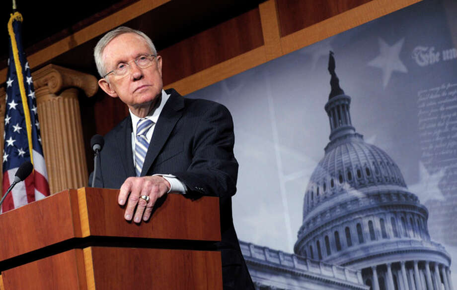 Senate Majority Leader Harry Reid of Nev. listens to a question during a news conference on Capitol Hill in Washington, Wednesday, Nov. 7, 2012, to discuss Tuesday's election results. (AP Photo/Susan Walsh) / AP