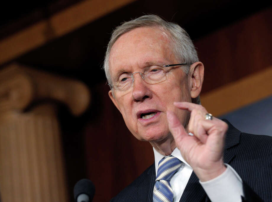 Senate Majority Leader Harry Reid of Nev. gestures as he discusses Tuesday's election results during a news conference on Capitol Hill in Washington, Wednesday, Nov. 7, 2012. (AP Photo/Susan Walsh) / AP