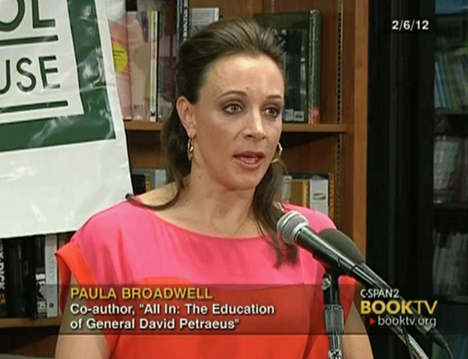 """In the frame grab from C-SPAN Book TV video taken Feb. 6, 2012, author Paula Broadwell speaks to an audience about the book she co-authored, """"All In: The Education of General David Petraeus,"""" at the Politics and Prose bookstore in Washington. The scandal that brought down CIA Director David Petraeus started with harassing emails sent by his biographer and paramour, Broadwell, to another woman, and eventually led the FBI to discover he was having an affair, U.S. officials told The Associated Press on Saturday, Nov. 10, 2012. Petraeus quit Friday, Nov. 9, after acknowledging an extramarital relationship. (AP Photo/C-SPAN Book TV) / C-SPAN Book TV"""