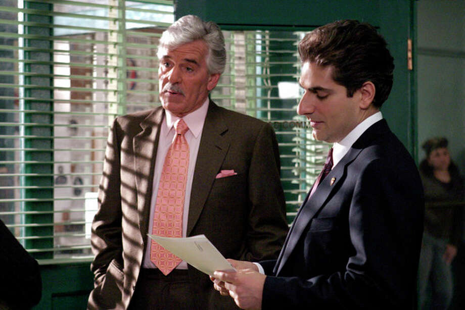 "FILE - In this undated photo from NBC Universal, Dennis Farina, who plays New York Police Detective Joe Fontana, acts in a scene with Michael Imperioli in the role of Detective Nick Falco, in an episode from NBC's police drama,""Law & Order."" Farina died suddenly on Monday, July 22, 2013, in Scottsdale, AZriz., after suffering a blood clot in his lung. He was 69. (AP Photo/ NBC Universal,Jessica Burstein) / NBC UNIVERSAL"