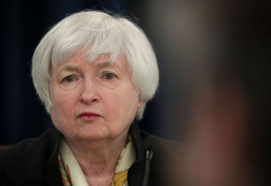 Federal Reserve Board Chair Janet Yellen listens during a news conference Wednesday.  Photo: Alex Wong, Getty Images