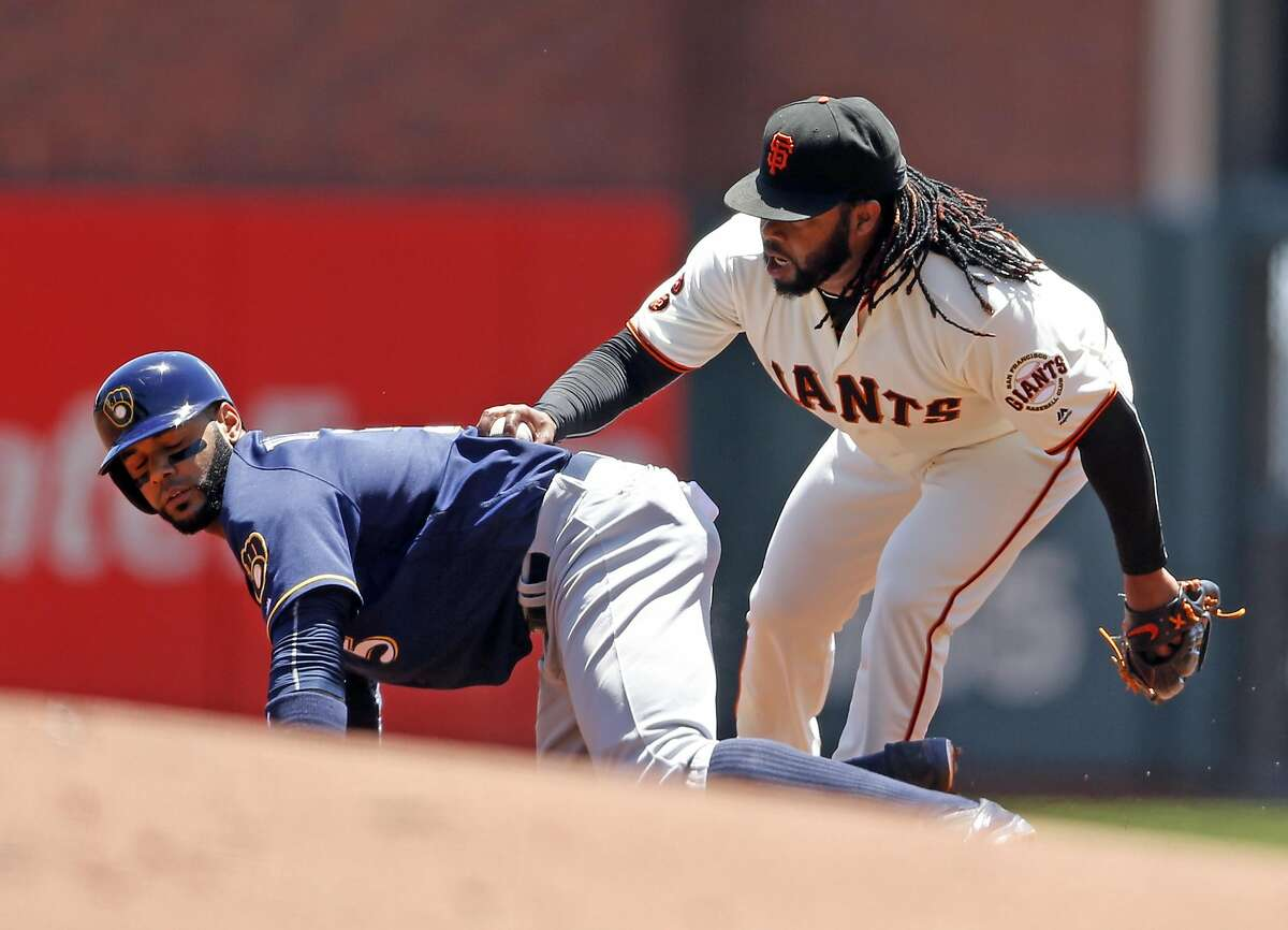 San Francisco Giants' pitcher Johnny Cueto, who - as Milwaukee's Jonathan Villar found out - has one of the game's best pickoff moves, wasn't thrilled the new rules regarding the play that will be put in place in the minor leagues this season.
