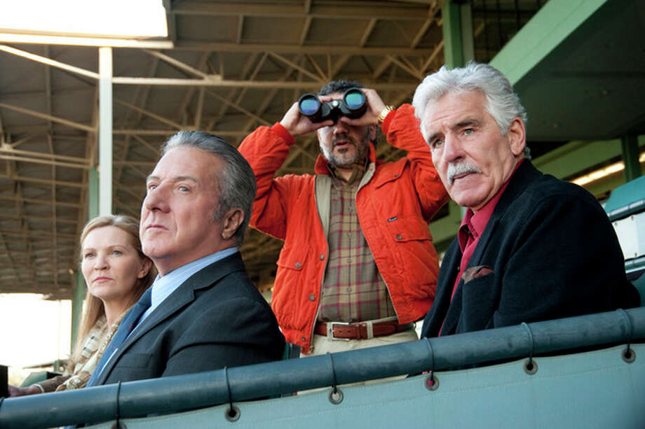 """In this undated image released by HBO, from left, Joan Allen, Dustin Hoffman, John Ortiz and Dennis Farina are shown in a scene from the HBO original series """"Luck."""" Farina died suddenly on Monday, July 22, 2013, in Scottsdale, AZriz., after suffering a blood clot in his lung. He was 69. (AP Photo/HBO, Gusmano Cesaretti, File ) / HBO"""