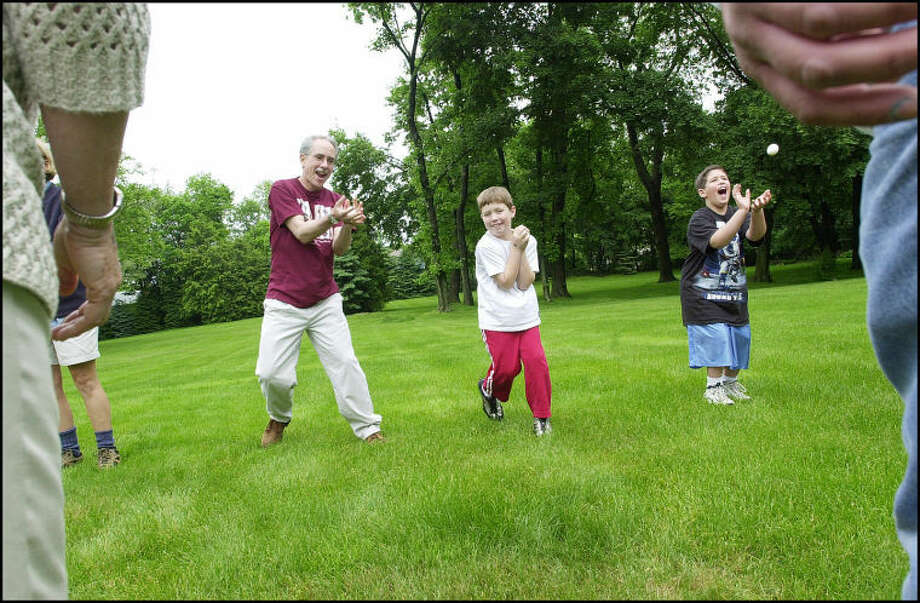 Council member, Bruce Kimmel, Will Atkin 9 and Justin Poruban 8, play egg toss at the home of Dr.Andrew Glickson for the Town Democratic Committee Family Fun day..photo matthew vinci