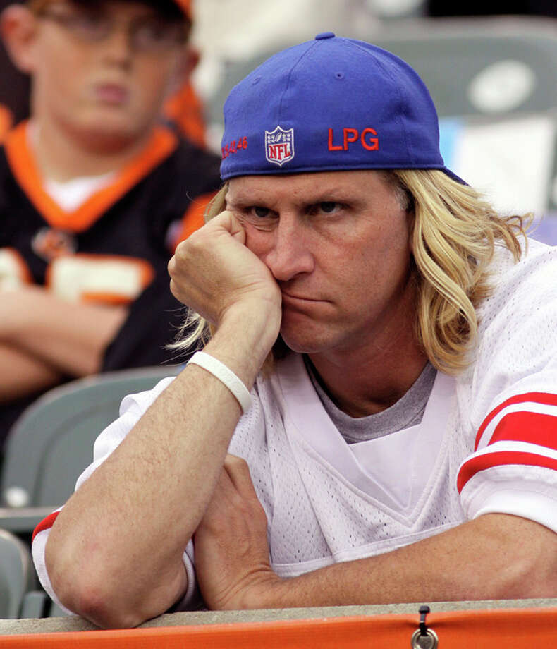 A New York Giants fan watches in the closing minute of a 31-13 loss to the Cincinnati Bengals in an NFL football game on Sunday, Nov. 11, 2012, in Cincinnati. (AP Photo/Tom Uhlman) / FR31154 AP