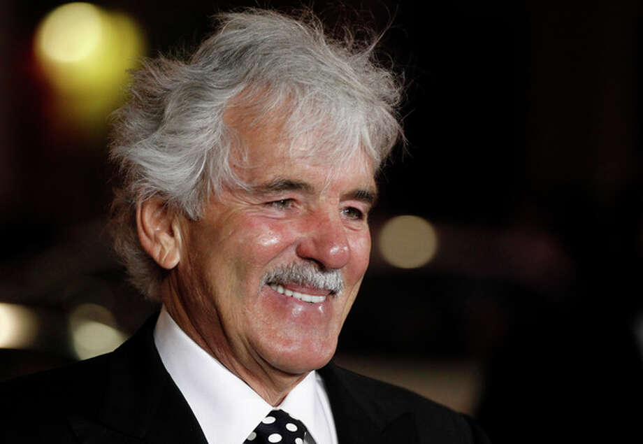"""FILE - In this Jan. 25, 2012 file photo, Dennis Farina arrives at the premiere for the HBO television series """"Luck"""" in Los Angeles. Farina died suddenly on Monday, July 22, 2013, in Scottsdale, AZriz., after suffering a blood clot in his lung. He was 69. (AP Photo/Matt Sayles, File) / AP"""