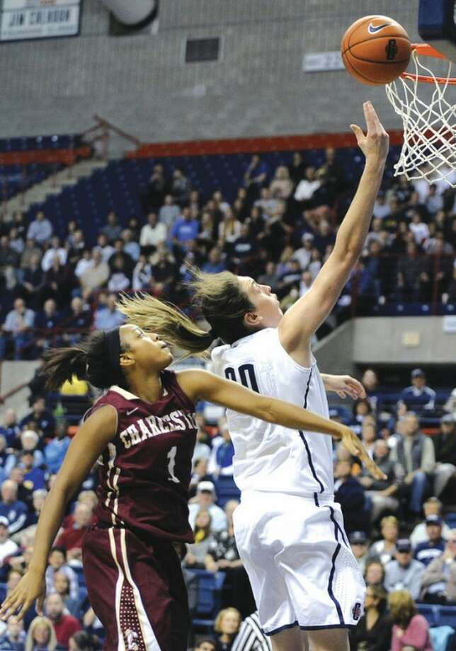 AP photoUConn freshman Breanna Stewart, right, drives past Charleston's Alyssa Frye during the first half of Sunday's game at Gampel Pavilion in Storrs. Making her collegiate debut, Stewart scored a game-high 21 points as the Huskies won their 17th straight season opener. UConn rolled to a 103-39 victory over the Cougars.