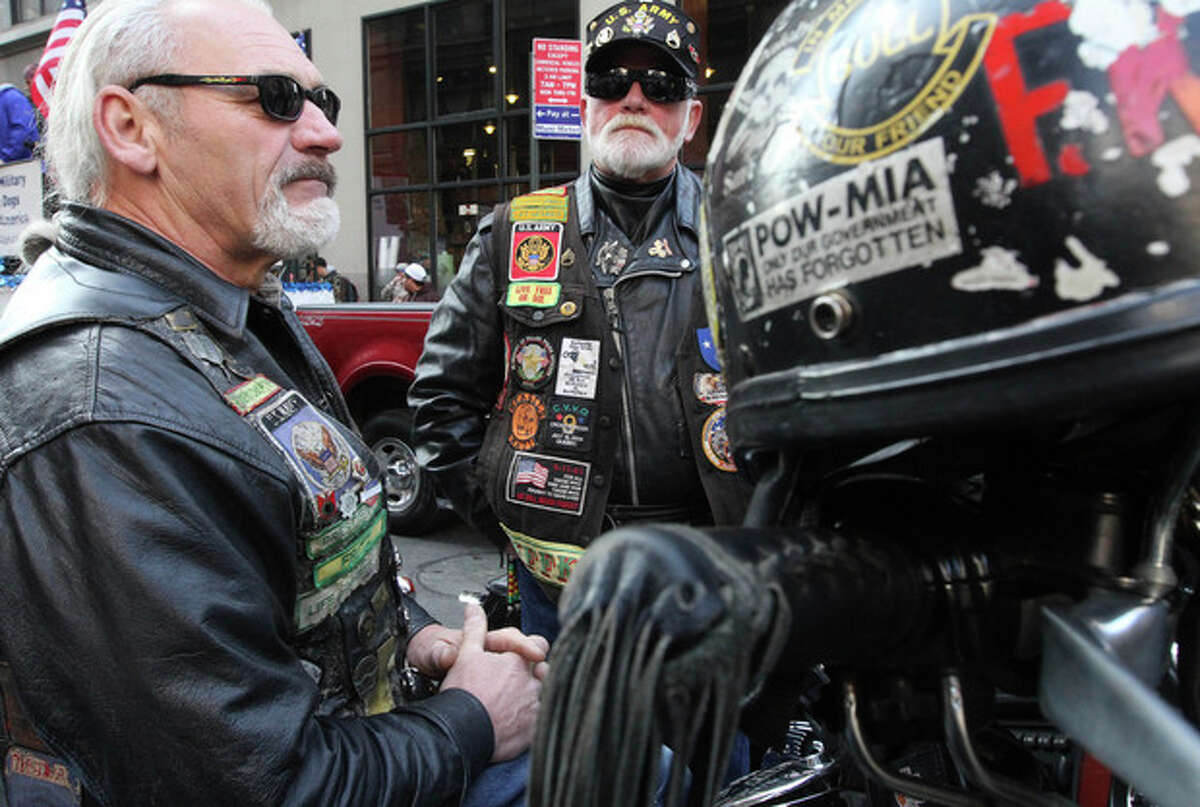 Vietnam War veterans Fred Reiman, of Norwood, N.J., left, and Rick Frato, of Township of Washington, N.J., wait to take part in the Veterans Day Parade Sunday Nov. 11, 2012 in New York. Both Rieman and Frato are with the Nam Knights. (AP Photo/Tina Fineberg)