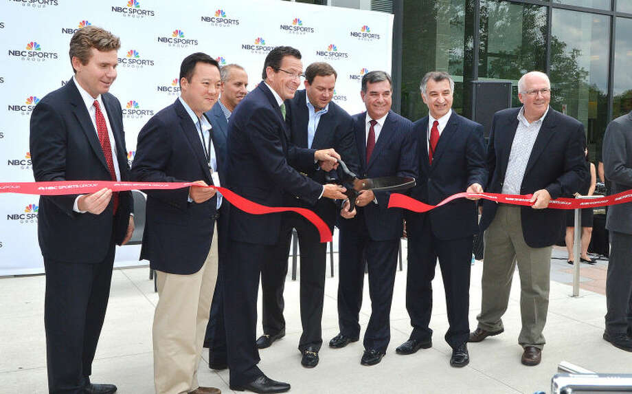 Hour Photo/Alex von Kleydorff . A ribbon is cut to celebrate NBC Sports Group in Stamford Wednesday
