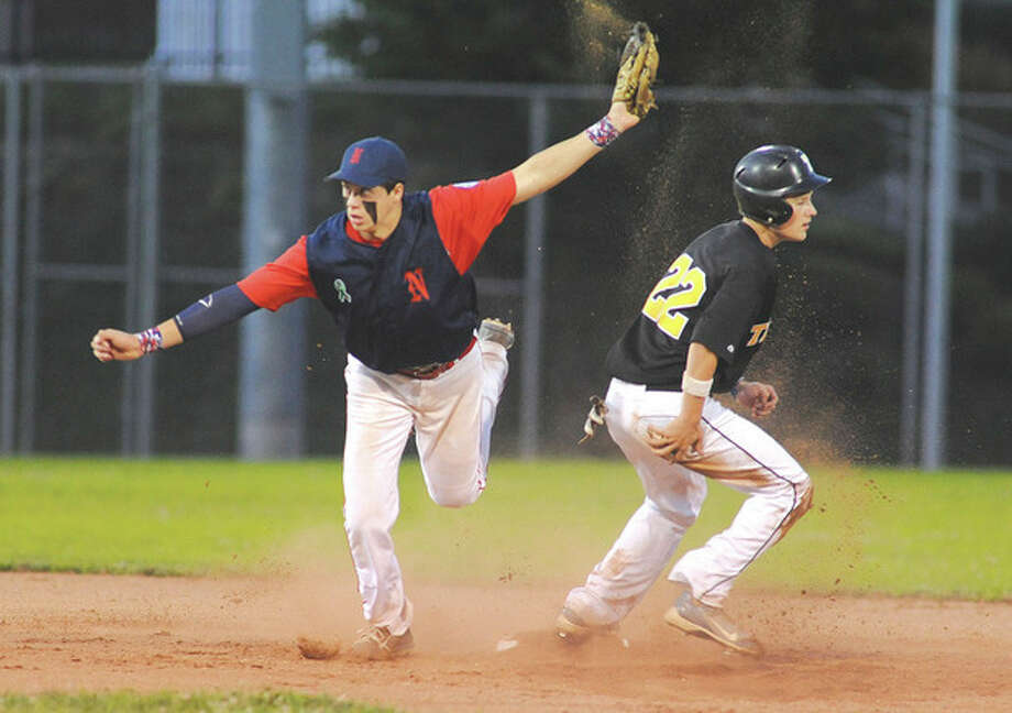 Hour photo/John NashNorwalk Babe Ruth second baseman Dan Romanello pulls up from his tag as Trumbull's baserunner was thrown out trying to steal during Wednesday's winner's bracket final of the 15-year-old Babe Ruth state tournament in Norwalk. Norwalk won, 5-0