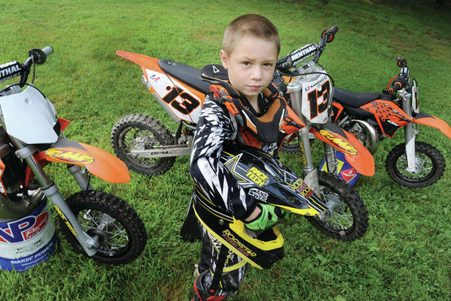 Hour photo/Matthew VinciAntonio Sandalo, 7, seen here at home in Stamford, will compete in a national motocross race.