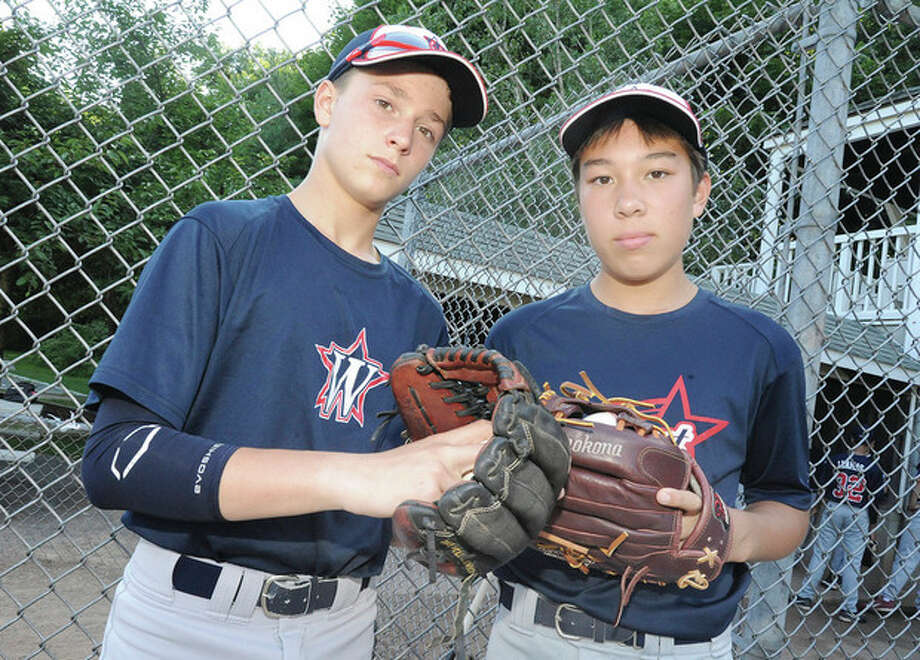 Hour photo/Matthew VinciChad Knight, left, and Harry Azadian are two of the mainstays of the pitching staff for the Westport Little League team that has gone unbeaten in postseason play this summer and will be in action in the New England Regional tournament beginning Friday in Bristol.
