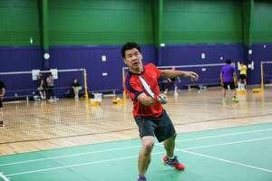 Noo Krisananuwat returns the bird to his opponent. -- Daniel McQuade photos