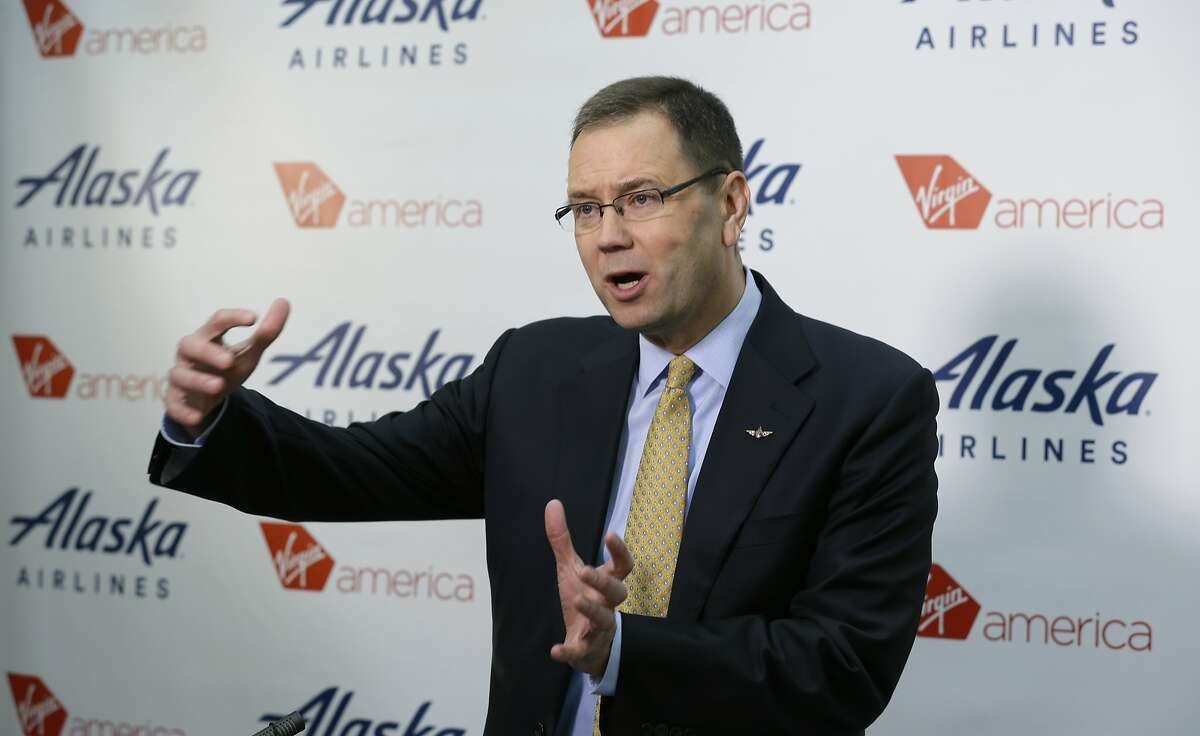 FILE - In this Monday, April 4, 2016, file photo, Alaska Airlines president and CEO Brad Tilden talks to reporters at the airline's corporate headquarters in Seattle. Tilden said Wednesday, June 15, 2016, that he might keep the Virgin America brand, running it and Alaska as two different products within the same airline group. (AP Photo/Ted S. Warren, File)