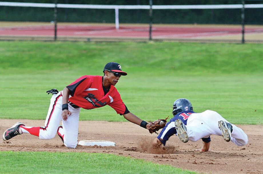 Hour photo/Erik TrautmannNorwalk second baseman Edwin Owolo, left, applies the tag as Jeff Sam of Trumbull slides into the bag during Wednesday's Junior Legion state tournament quarterfinal game in Bethel. Top-seeded Norwalk lost, 3-2, after Owolo appeared to score the tying run in the seventh inning only to be ruled out on appeal. / ©2012 Pascal Photographic Studios