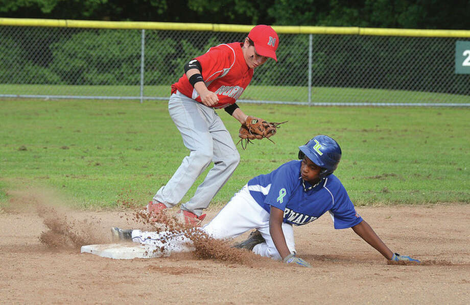 Hour photo/Alex von KleydorffCal Ripken's David Broncati slides safely into second base during Wednesday's Game 2 of the Kinlock Tournament. Scott Whalen of Norwalk Little League covers the bag on the play. Little League took a 9-8 victory to even the series at one game apiece.