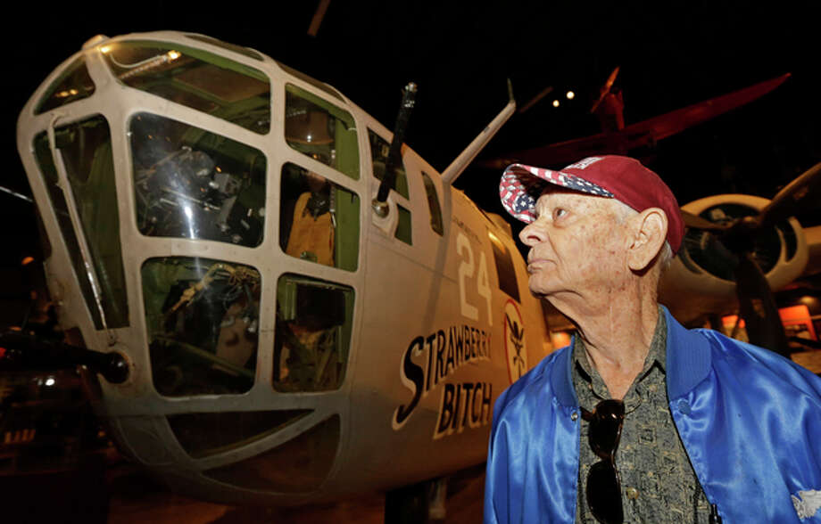 Dale Hulsey, from Forth Worth Texas, views a B24 bomber like the one he flew in the Ploesti Raid during World War II while touring the United States Air Force Museum, Wednesday, July 31, 2013, in Dayton, Ohio. The planes flew a dangerous low altitude raid on Aug. 1, 1943, targeting heavily defended oil fields in occupied Romania. Survivors of the raid are having a 70th reunion Thursday in Dayton. (AP Photo/Al Behrman) / AP