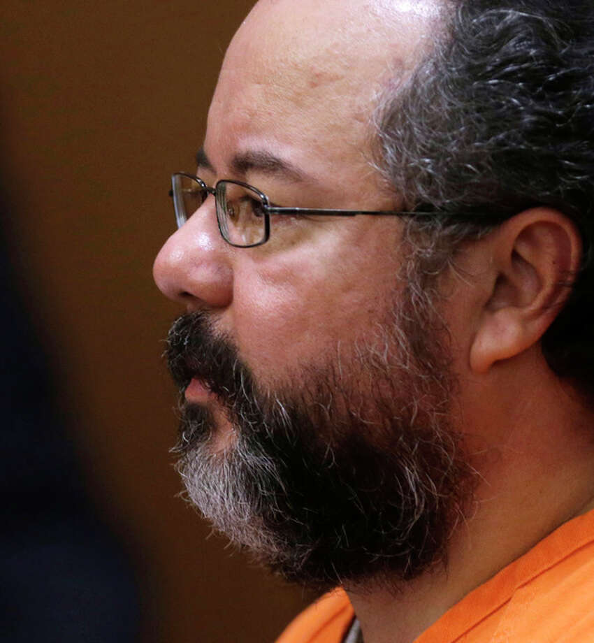 Ariel Castro looks at the judge during court proceedings Friday, July 26, 2013, in Cleveland. Castro, who imprisoned three women in his home, subjecting them to a decade of rapes and beatings, pleaded guilty Friday to 937 counts in a deal to avoid the death penalty. In exchange, prosecutors recommended Castro be sentenced to life without parole plus 1,000 years. (AP Photo/Tony Dejak) / AP