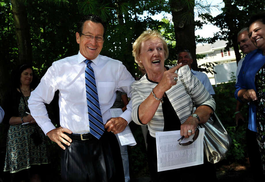Connecticut Gov. Dannel P. Malloy, left, and Newtown First Selectwoman Patricia Llodra talk before a tour the downtown business district of Sandy Hook in Newtown, Conn., Wednesday, July 31, 2013. Malloy is visiting to meet with business owners and talk about economic recovery after the December elementary school shooting that killed 20 students and six adults. (AP Photo/Jessica Hill) / FR125654 AP