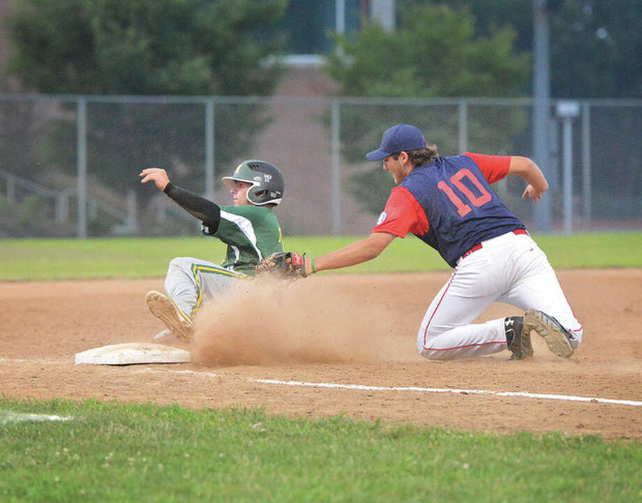 Hour Photo/Alex von KleydorffNorwalk's Christian Lengyl, right, tags New Milford's Jack Titus out at third base before getting up to throw to second to complete a double play during Friday night's Babe Ruth 15-year-old state tournament game at Brien McMahon High School. Norwalk, the host team for the tournament, rolled to a 9-5 victory in the opening game for both teams.