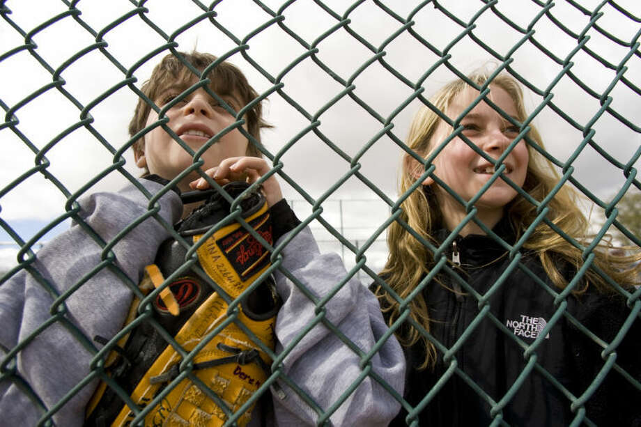 In this February 2009 photo of the Arizona Diamondbacks Spring Training, A.J. Cina, 8, and his sister, Kelsey Cina, 9, of Weston, watch the Diamondbacks' pitchers and catchers workout during Spring Training at the Kino Sports Complex in Tucson.