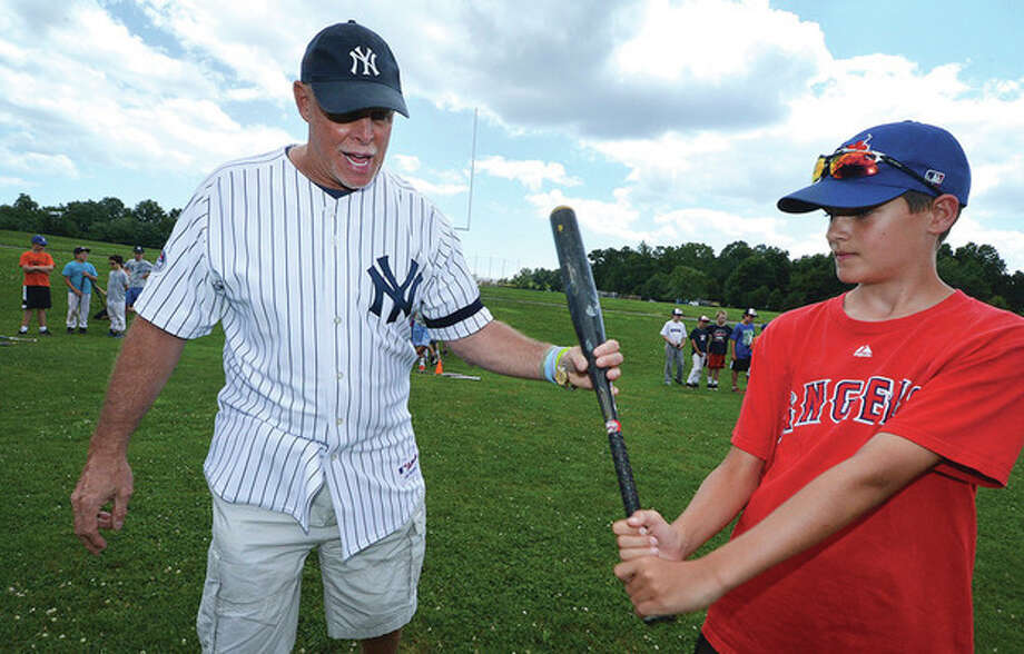 Hour photo/Alex von KleydorffFormer major leaguer Ron Blomberg, left, helps 12-year-old Nick Peloso with his swing at the Baseball World camp in Westport. Blomberg, who 40 years ago was the first designated hitter to appear in an MLB game, was the guest instructor at Tuesday's session of the Westport camp.