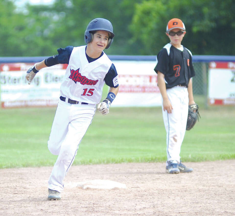 Hour photo/John NashRicky Offenberg of Westport rounds the bases after hitting a solo homer in the fourth inning of Saturday's Little League state sectional game against Orange. Offenberg's fourth-inning blast snapped a 3-3 tie and Westport went on to claim a 5-3 victory.