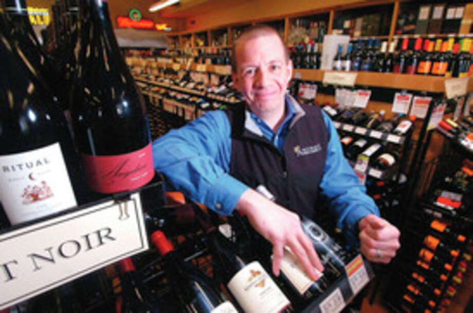 Hour photo / Alex von KleydorffMitch Ancona, owner of Ancona's Wines and Liquors near the Pinot Noir's in his Ridgefield Store.