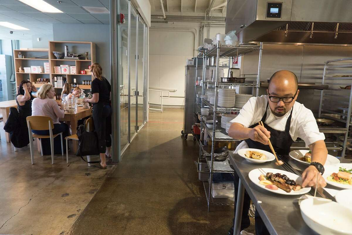 Henry Eng prepares food for diners at Kitchentown in San Mateo, Calif. on Wednesday, June 15, 2016. Rocketspace, a tech startup campus is launching a food accelerator where food tech startups will be able to work at Kitchentown.