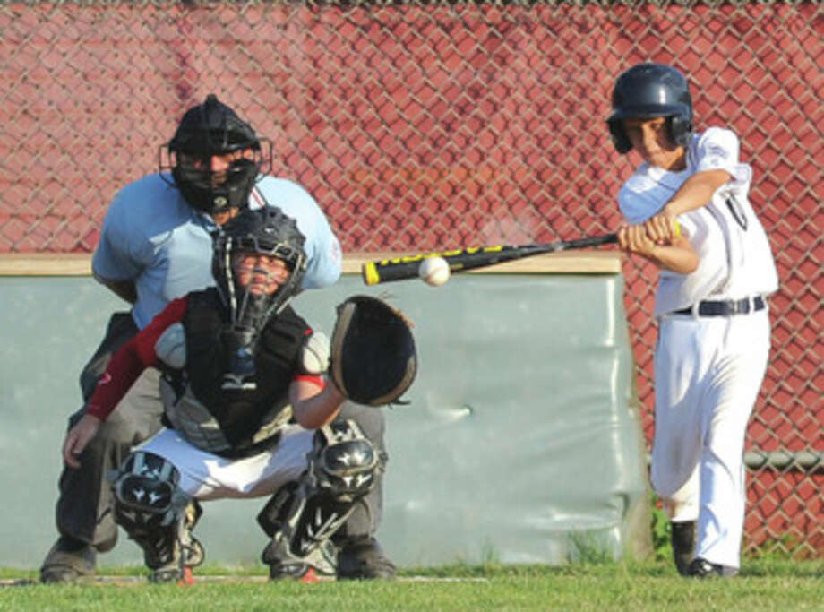 Hour photo/John NashWilton's Andrew Travers laces a two-run game-tying single in the third inning of Wednesday's Little League 10-year-old sectional game against Fairfield American. The Fairfield entry scored the game's next 10 runs on the way to a 13-2 victory.
