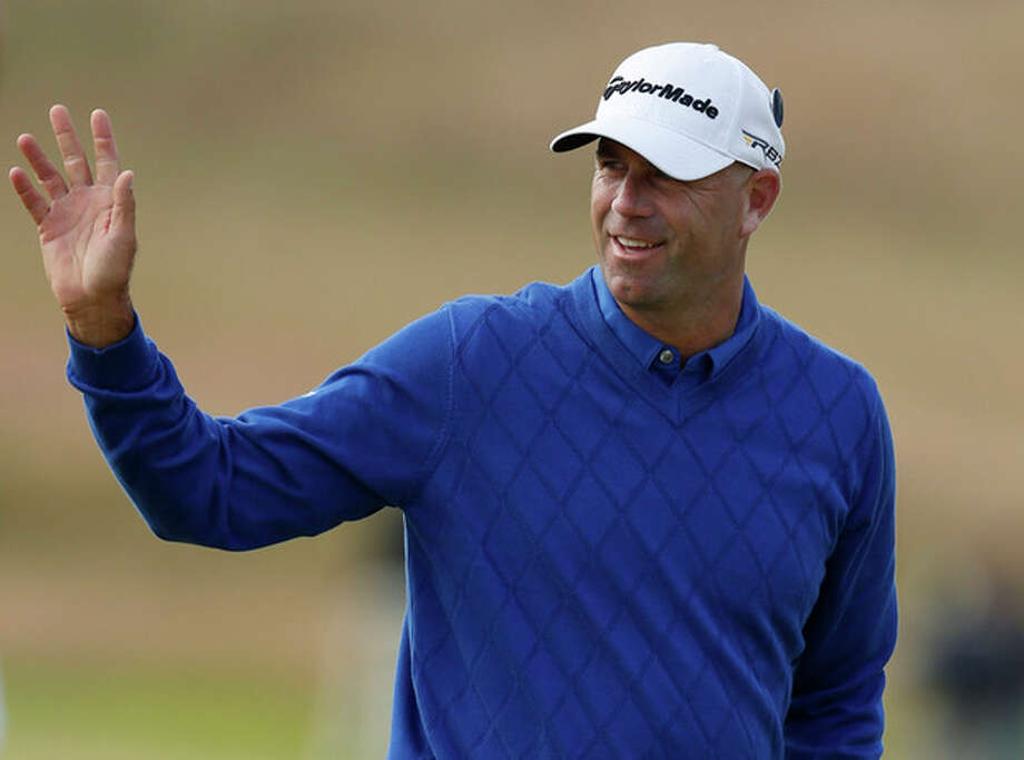 Stewart Cink of the United States reacts after his birdie on the second green during the first round of the British Open Golf Championship at Muirfield, Scotland, Thursday July 18, 2013. (AP Photo/Matt Dunham) / AP