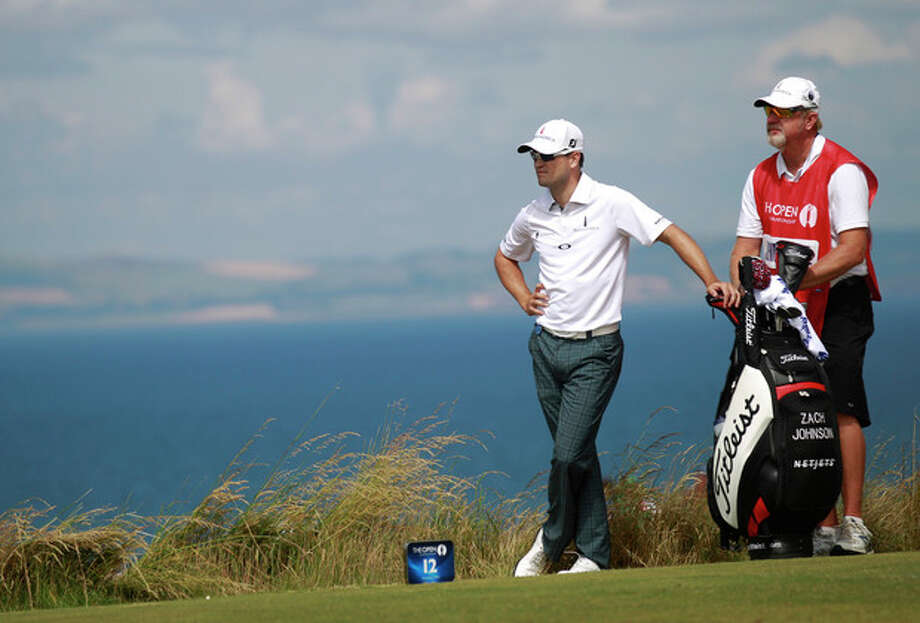 Zach Johnson of the United States prepares to play off the 12th tee during the first round of the British Open Golf Championship at Muirfield, Scotland, Thursday July 18, 2013. (AP Photo/Peter Morrison) / AP