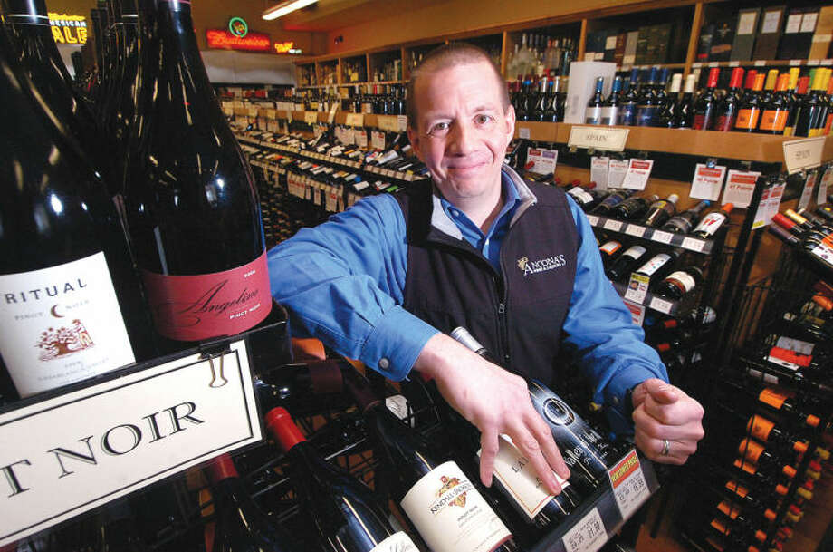 Photo/Alex von Kleydorff. Mitch Ancona, Owner of Ancona's Wines and Liquors near the Pinot Noir's in his Ridgefield Store.