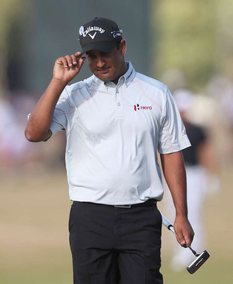 Shiv Kapur of India reacts after putting on the 9th green during the first round of the British Open Golf Championship at Muirfield, Scotland, Thursday July 18, 2013. (AP Photo/Scott Heppell) / AP