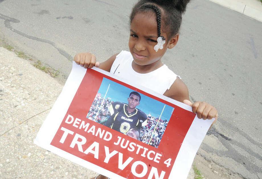 Hour photo/Matthew VinciTamia Samuel 5, Sunday at the Norwalk Police Headquarters at the Trayvon Martin rally.