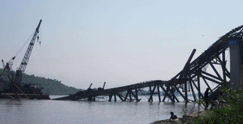 A bridge under construction across the Irrawaddy River, east of Shwebo, Myanmar is seen collapsed after a strong earthquake on Sunday, Nov. 11, 2012. The magnitude-6.8 quake struck northern Myanmar on Sunday, collapsing the bridge and a gold mine, damaging several old Buddhist pagodas and leaving as many as 12 people feared dead. The bridge links the town of Sintku, 65 kilometers (40 miles) north of Mandalay on the east bank of the Irrwaddy with Kyaukmyaung on the west bank. (AP Photo/Weekly Eleven News) MANDATORY CREDIT / Weekly Eleven News