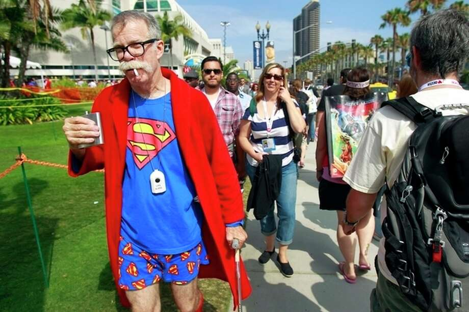 Gary McAuley, dressed as retired Superman, attends Comic-Con, Friday, July 19, 2013, in San Diego. (AP Photo/U-T San Diego, K.C. Alfred) / The U-T San Diego