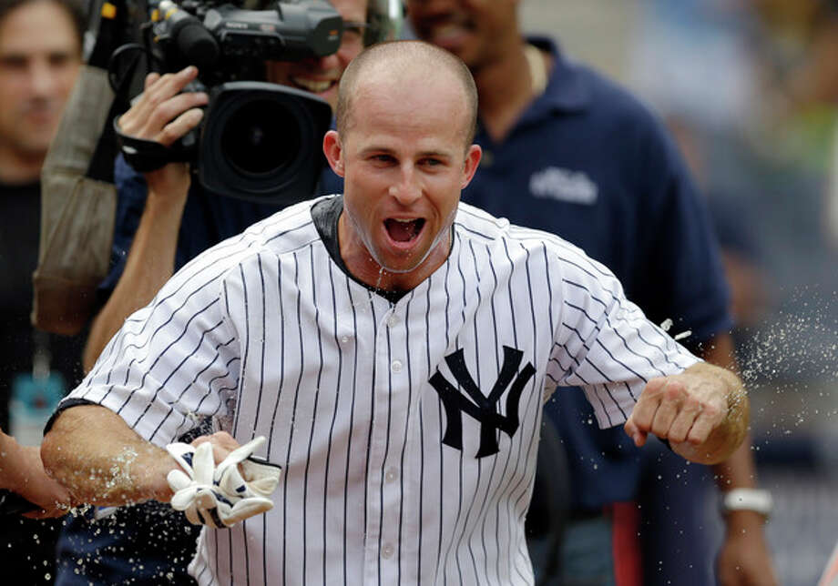 New York Yankees' Brett Gardner reacts after teammates doused him after he hit a ninth-inning walkoff solo home run in a baseball game against the Detroit Tigers, Sunday, Aug. 11, 2013, in New York. (AP Photo/Kathy Willens) / AP
