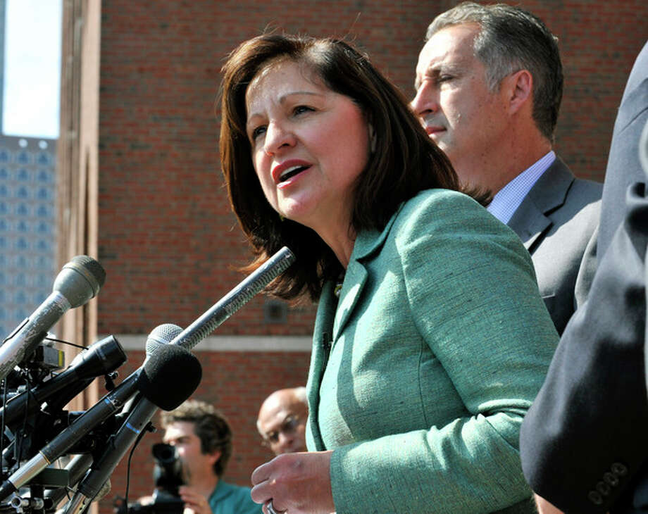 "U.S. Attorney Carmen Ortiz speaks outside federal court Monday, Aug. 12, 2013, where a jury found James ""Whitey"" Bulger guilty on several counts of murder, racketeering and conspiracy Monday, Aug. 12, 2013 in Boston. (AP Photo/Josh Reynolds) / FR25426 AP"