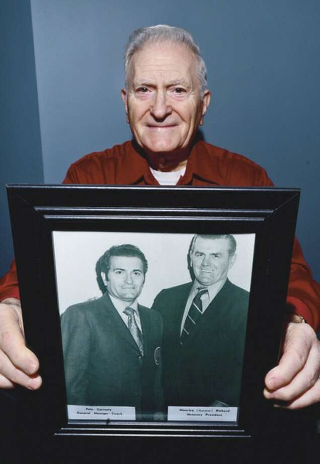 Hour Photo/Erik TrautmannPeter Correnty holds the photo of him and hockey legend Rocket Richard -- taken back in the 1960s -- that spurred his conversation with Canadian power company workers working in his neighborhood post-Sandy.