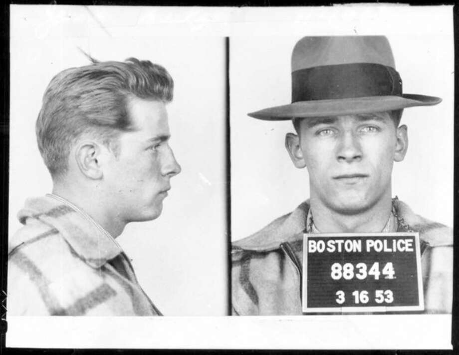 "FILE - This 1953 Boston police booking file photo combo shows James ""Whitey"" Bulger after an arrest. A jury on Monday, Aug. 12, 2013 found Bulger guilty on several counts of murder, racketeering and conspiracy in federal court in Boston.(AP Photo/Boston Police, File) / Boston Police"