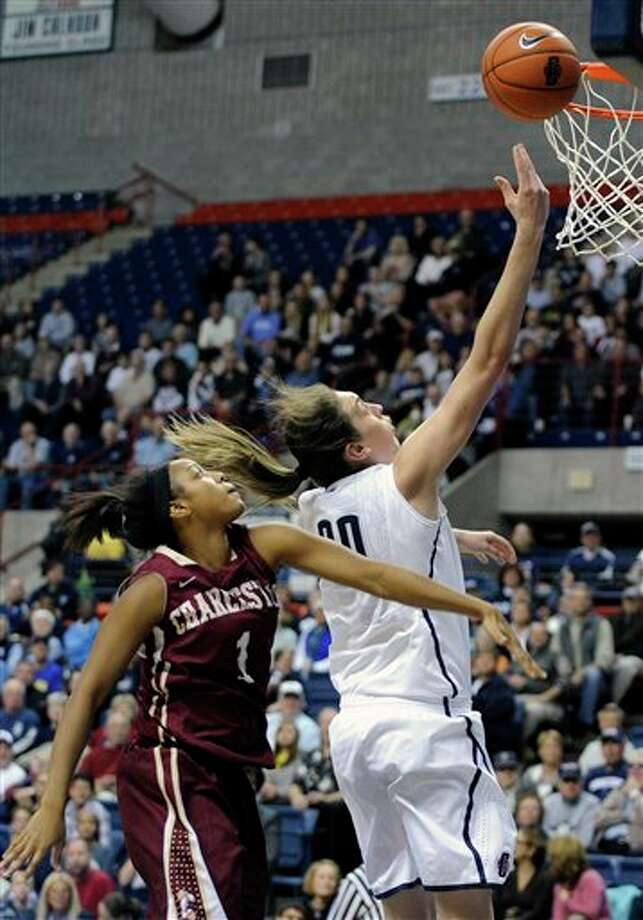 Connecticut's Breanna Stewart, right, drives past Charleston's Alyssa Frye during the first half of an NCAA college basketball game in Storrs, Conn., Sunday, Nov. 11, 2012. Stewart scored a game-high 21 points and Frye a team-high 14 in Connecticut's 103-39 victory. (AP Photo/Fred Beckham) / FR153656 AP