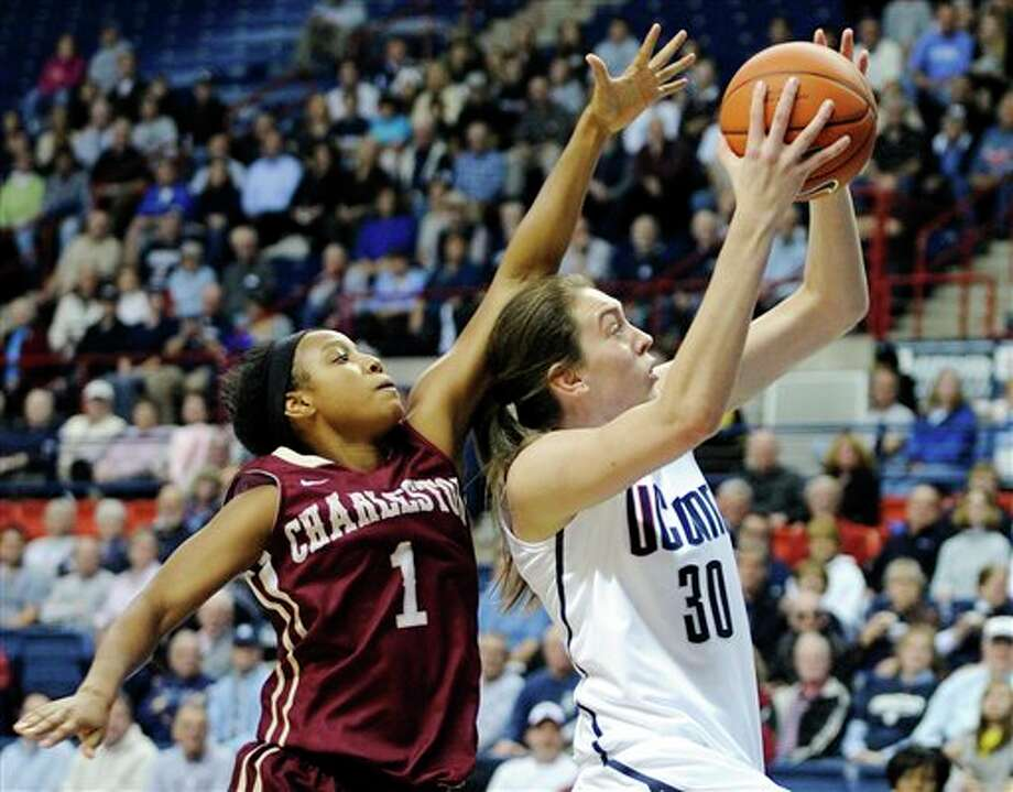 Connecticut's Breanna Stewart (3) drives past Charleston's Alyssa Frye during the first half of an NCAA college basketball game in Storrs, Conn., Sunday, Nov. 11, 2012. (AP Photo/Fred Beckham) / FR153656 AP